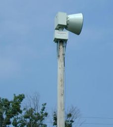 Fire Department siren on utility pole