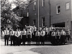 Historic photo of firemen lined up outside old City Hall, now Center for the Arts