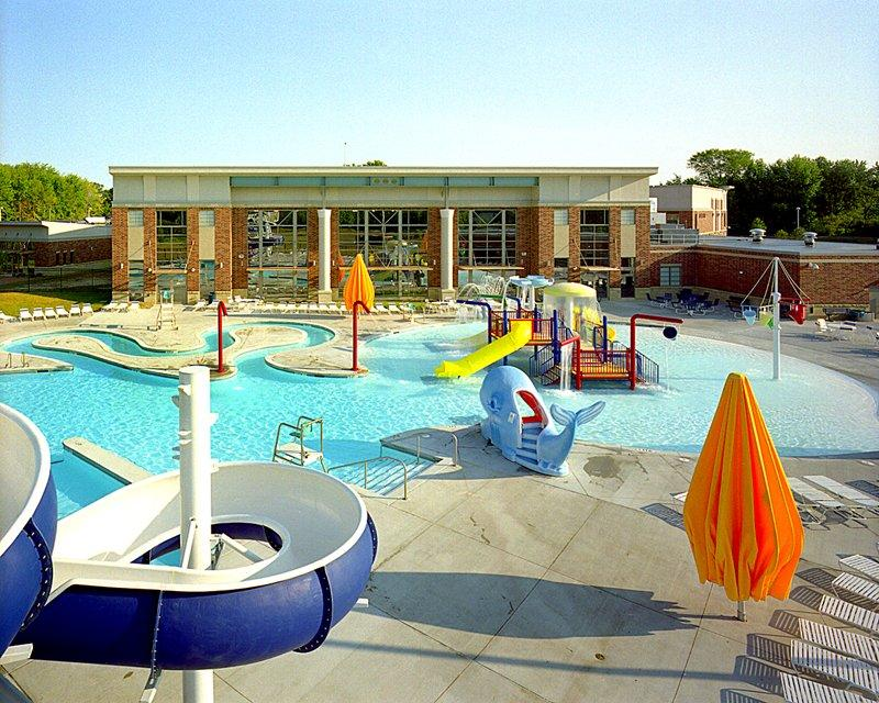 Outdoor Pool Complex with aquatic playground equipment