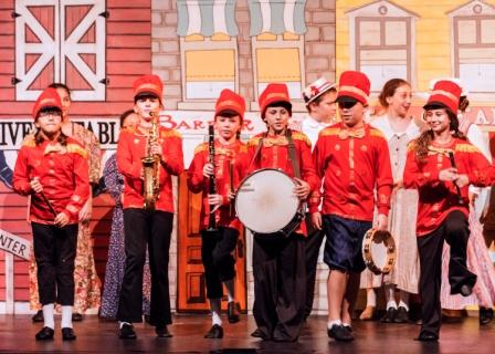 Boys in marching band on stage during Music Man performance